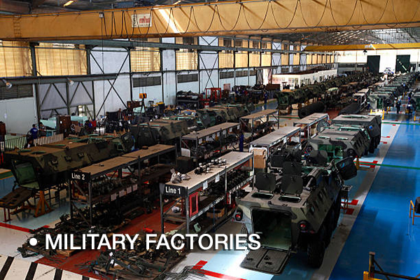 Rows of PT Pindad Anoa armored personnel carrier vehicles stand on the assembly line at the company's plant in Bandung, Indonesia, on Tuesday, Oct. 16, 2012. Indonesia may surpass Germany and the U.K. by 2030 to be the world's seventh-largest economy, generating $1.8 trillion in annual sales for agriculture, consumer and energy companies by that year, McKinsey & Co. said. Photographer: Dadang Tri/Bloomberg via Getty Images